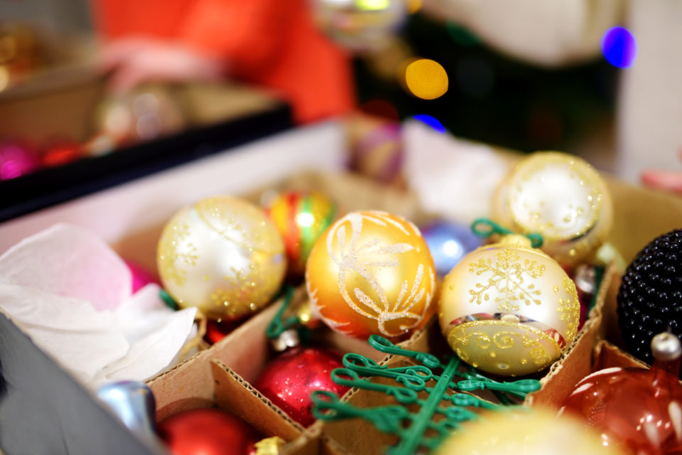 Various colorful Christmas decorations in boxes
