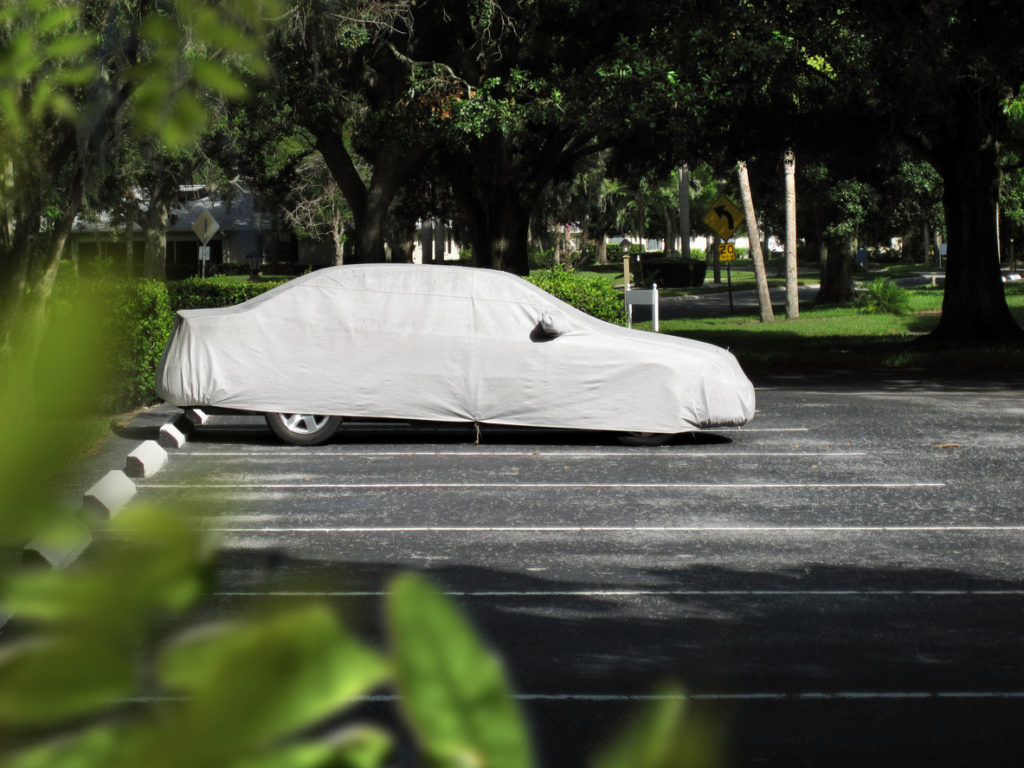 Covered car in parking lot